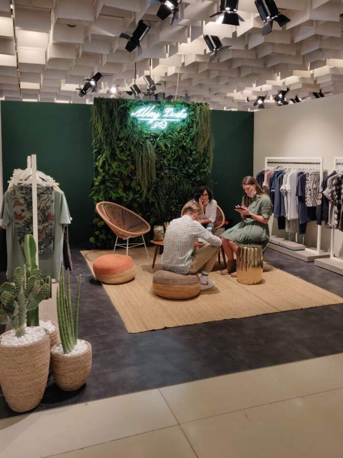 Green booth at Pitti
